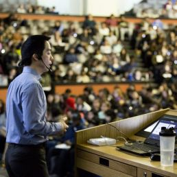 Kenneth Yip lecturing at Convocation Hall. Photo by Johnny Guatto